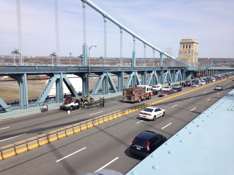 Traffic jammed behind a burned-out mini van on the Ben Franklin Bridge