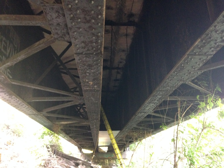 Underside of riveted steel girders supporting the Lower Marion approach.