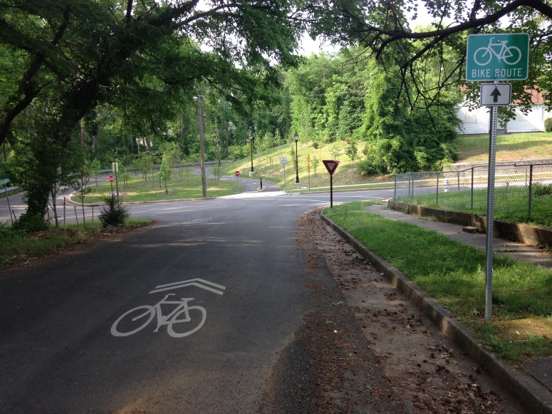 Two segments of trail are connected by a very appropriate use of shared lane makrings, on a low-traffic, low-speed neighborhood street.