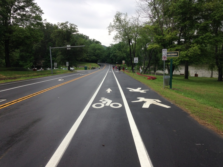 New arrangement on Ingomar Road with delineated bike/pedestrian space.  Speed-inducing 12-foot car/truck lanes remain.