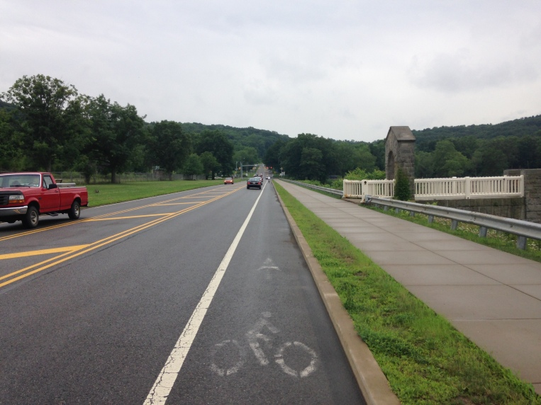 Babcock Boulevard (on the earthen dam) was given a bike lane a couple years ago.  Cars move faster on this stretch.