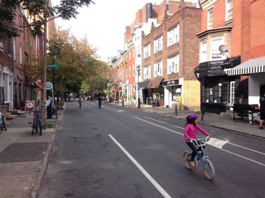 A child cycles on 10th Street